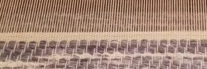 Avslutande mattvarpskant medans mattan är i vävstolen